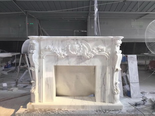 Hand carved natural decorative fireplace surround